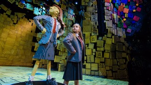 Emma Moore, who plays Matilda, with the Lego statue of her character.