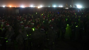 Soldiers wearing Santa hats
