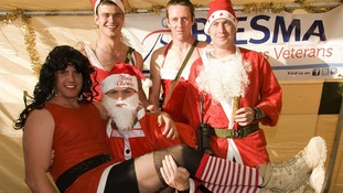 Santa, complete with helpers