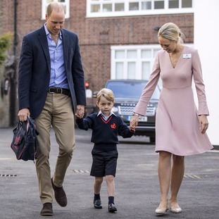 Prince George holding hands with the Duke of Cambridge and Helen Haslem, head of the lower school