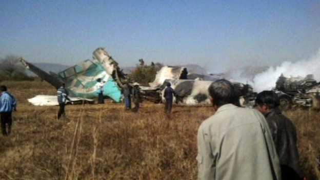 The wreckage of the plane in a rice paddy