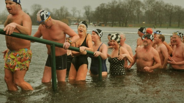 Swimmers feel the cold after their early morning Christmas swim