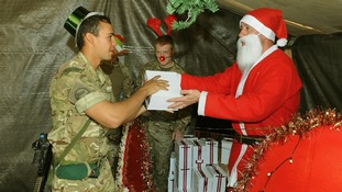 'Santa' hands out Christmas presents to British troops