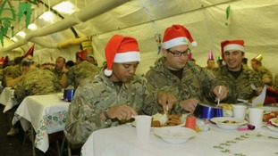 Troops tuck into their Christmas dinner