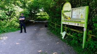 A police officer guards the scene at Orrell Water Park.