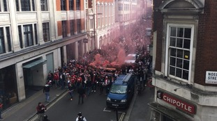 Cologne fans going through Central London.