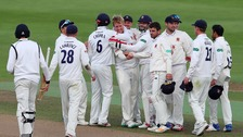 Essex's Simon Harmer is congratulated after taking the final Warwickshire wicket during the County Championship match at Edgbaston.