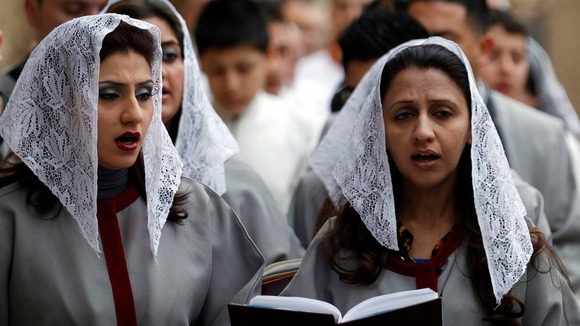 Iraqi Christians pray during a mass at St. Joseph Chaldean church in Baghdad
