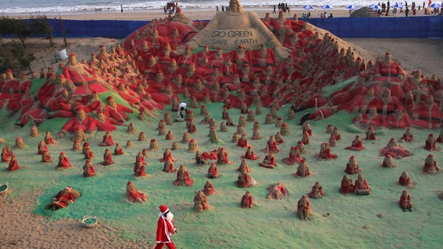 Santa sand sculptures created by artist Pattnaik at beach celebrations in Puri, India