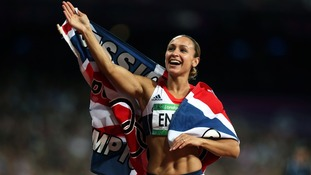 Jessica Ennis waves to the crowd after victory in the Heptathlon