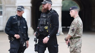 Armed police and a soldier in Whitehall.