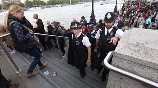 Cressida Dick walks amongst crowds at South Bank in London.