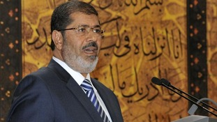 Mohamed Mursi says the new constitution will help fix Egypt's economy