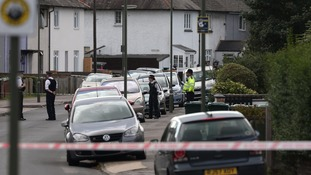 An address in Sunbury-on-Thames is searched by police.