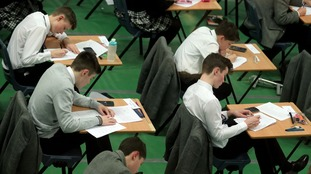 Students taking an exam earlier this year