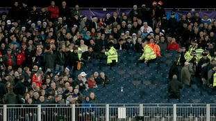 Police and stewards remove fans in the stands during the NatWest T20 match at the Emirates Riverside, Durham.