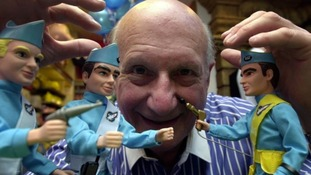 Gerry Anderson, with three of his famed Thunderbird puppets