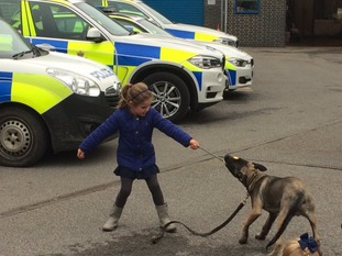 Gav and Kezi's daughter Tilly with new police pup Smithy