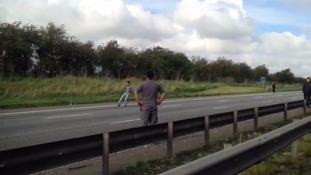 Motorists play football on the M1 to pass the time