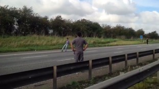 Motorists play football on gridlocked M1 shut due to 'suspicious object'