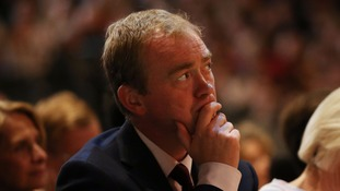 Former leader Tim Farron watched on.