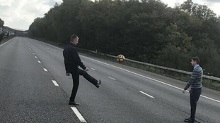 Bored drivers had games of football on the opposite carriageway