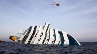 The Costa Concordia lies on her side in the Mediteranean Sea