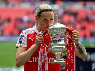 Arsenal's Kelly Smith celebrates with the trophy after winning the SSE Women's FA Cup Final at Wembley Stadium, London.