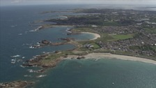 Jersey Sports Council says more needs to be done to improve transport links between the Channel Islands