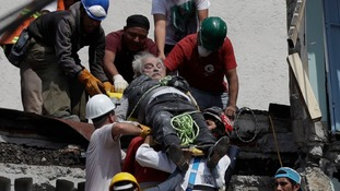 An injured man is pulled from a collapsed building in Mexico City.