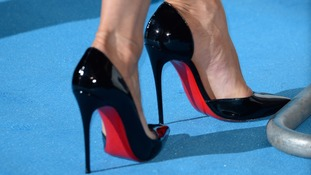 Actress Jennifer Aniston wears the trademark Louboutin shoes.