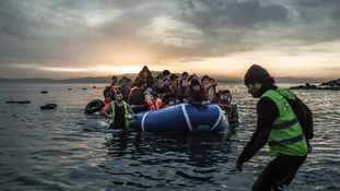 Refugees arrive on the small Greek island of Lesbos