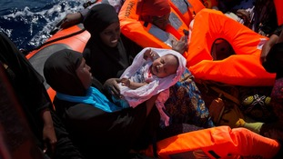 Nigerian women and children are rescued from a boat in the Mediterranean sea.