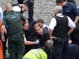Tobias Ellwood helps emergency services at Westminster after the terror attack in March