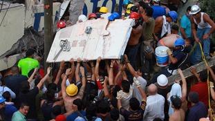 Rescue workers remove debris