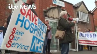 """We're angry that people in there are carving up our NHS"""