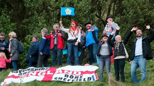Spectators watch stage one of the Tour de Yorkshire between Bridlington to Scarborough.
