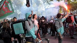 Deliveroo riders in France protest for an increase in pay.