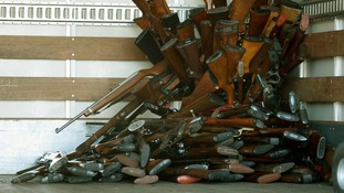 Weapons, including assault rifles, were collected at the event.