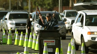 Police officers dispose of the weapons in Los Angeles.