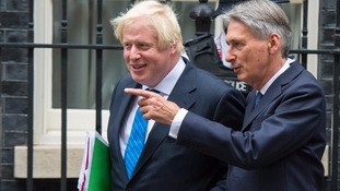 Boris Johnson and Phillip Hammond leave 10 Downing Street.