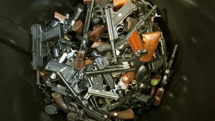 Hundreds of hand guns were turned in by their owners at an amnesty event in Los Angeles.