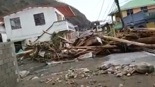 Debris lays all over a street in Dominica.