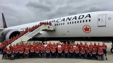 Invictus team members prepare to fly to Canada.