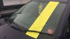 Car with go-faster stripe on windscreen seized by police