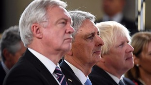 David Davis, Philip Hammond and Boris Johnson listen to Mrs May's speech.