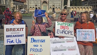 Protesters outside Mrs May's speech venue in Florence.