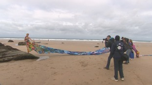 The dress is over 22 metres in length and aims to highlight the issue of people dumping boards on beaches.
