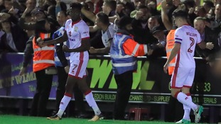 Gboly Ariyibi celebrates doubling MK Dons' lead.