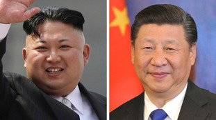 North Korean leader Kim Jong Un (L) and Chinese President Xi Jinping.